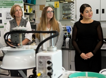 Christina Davy, research scientist, left, Amanda Stubbs, a Trent University masters student, and Peterborough-Kawartha MP Maryam Monsef, listen to a presentation in a Trent lab in Peterborough, Ont. on Tuesday, Oct. 9, 2018. Monsef announced $2.4 million in funding for a dozen researchers at Trent.