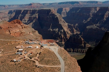 FILE - In this March 20, 2007, file photo, the Skywalk hangs over the Grand Canyon on the Hualapai Indian Reservation before its grand opening ceremony at Grand Canyon West, Ariz. Two recent deaths in which men plummeted to their death in the Grand Canyon follow dozens of apparently accidental fatal falls since the national park was established 100 years ago. (AP Photo/Ross D. Franklin, File)