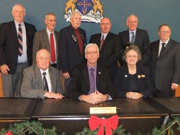 The new South Frontenac Council (back row from left) Alan Revill, Ross Sutherland, Bill Robinson, Mark Schjerning, John McDougall, Norm Roberts. Front row: Ron Sleeth, Mayor Ron Vandewal, Pat Barr.