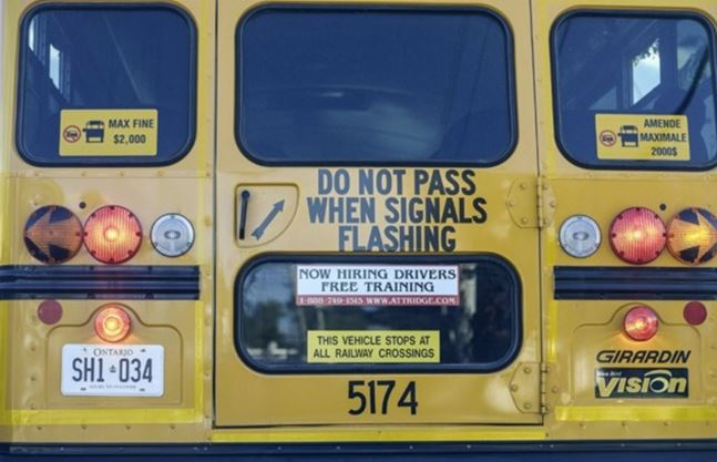 Two drivers charged the same day after passing school buses with lights activated