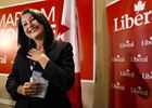 MP-elect Maryam Monsef responds to the applause from her supporters.