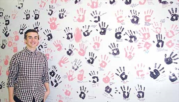 Arnprior District High School student council member Mike Clarke shows off the handprint wall in the school cafeteria that was part of a fundraiser for CHEO's mental health unit. Last fall, students raised about $550 by having students make a donation in order to put their handprint and signature on the wall. The fundraiser was held in conjunction with DIFD (Do it for Daron), a youth-driven initiative focused on raising awareness and inspiring conversations about youth mental health. DIFD was created by friends and family of Daron Richardson who lost her life to suicide at the age of 14. DIFD supports programs and initiatives aimed at transforming youth mental health. Pink and purple paint was used on the handprint wall as pink is associated with anti-bullying and purple was Richardson's favrourite colour. The ADHS initiative was organized by the student council and spearheaded by Hailey Barr.