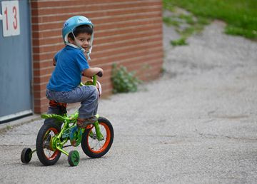 Alexander Zilli, 4, bikes around during the Sunningdale Public School Bike Rodeo/Rally on Wednesday night.