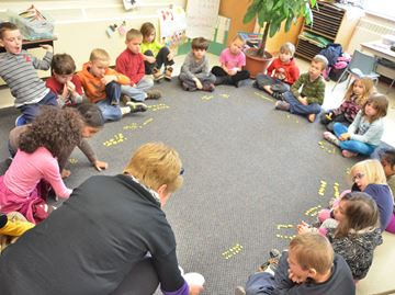 A Grade 1 class learns math lessons while in a learning circle at Caledon Central Public School.