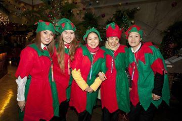 Mandarin Restaurant staff members dressed as elves to greet the customers on Tuesday night. From left: Priscilla, Kinga, Bella, Rita, and Lisa.