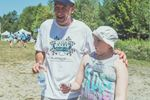 Actor Bill Baldwin jokes with a youngster at the fourth annual Boat Rally for Kids on lakes Joseph and Rosseau Saturday.