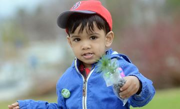 Mahmood Gabriel, 2, is going to plant this little tree and watch it grow.