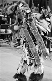 Theland Kicknosway performs a dance at the annual Ottawa Children and Youth Traditional Powwow at Carleton University on March 29. Theland, 10, lives in Nepean but is from Walpole Island. The powwow featured many dances, as well as traditional crafts for sale.
