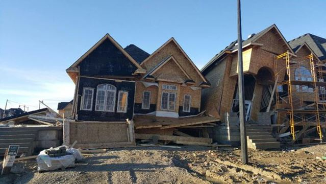 Houses under construction blow over as strong winds for Modern homes mississauga