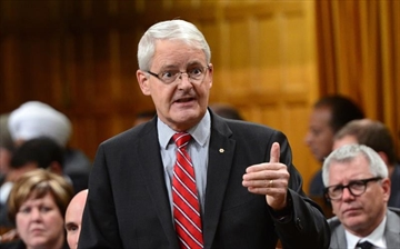 Minister of Transport Marc Garneau stands during question period in the house of commons on Parliament Hill in Ottawa on Thursday, Sept. 21, 2017. Officials say the World Anti-Doping Agency has agreed to renegotiate its existing deal with Montreal to keep its headquarters in the city. THE CANADIAN PRESS/Sean Kilpatrick
