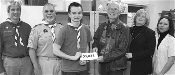 At the presentation of a donation of $1,831 to the Stittsville Food Bank as the cash proceeds from the recent Scout-Guide food drive in Stittsville are, from left, Scouter Michael Leeder of the 1st Stittsville Scouts