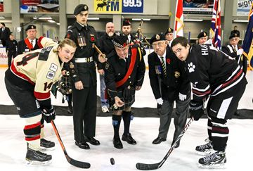 Members of the Royal Canadian Legion Branch 302 held a special Rememberance Day service before the Friday's game. A member of the  Correctional Service Canada Community Pipes & Drums dropped the puck for Brandon Luksa and Jim Steel from a player from the Huskies.