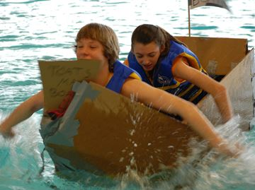 It's all about getting to the finish line before there boat doesn't float anymore during the cardboard boat races at the Innisfil YMCA Thursday.