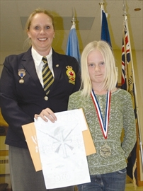 Community - Victoria Watt-Runge receives her medal and certificate from Tammy Peckham, youth education chair at the Royal Canadian Legion Branch 95 on April 1, for placing first at the Zone level for her black and white poster.