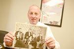 Ken Barrick holding photo of Don Barrick