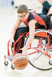 Wyatt Simms picks up a loose ball during a wheelchair basketball scrimmage at the University of Toronto Scarborough Campus. Students from St. Andrews Public School were at UTSC to learn about wheelchair basketball and try it out for themselves.