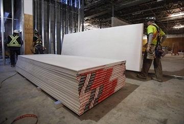 Fire-affected families get drywall duty break-Image1