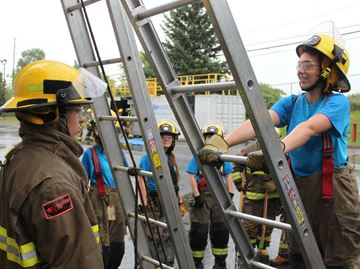Young women learn firefighting ropes from the pros