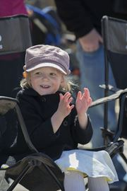Aibhlin Bradley, 3, applauds the affair along the route of the Toronto Beaches Lions Easter Parade April 20.