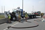 Truck drives into cement barrier on QEW through Burlington