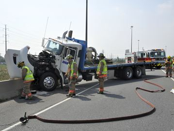 Truck drives into cement barrier on QEW through Burlington