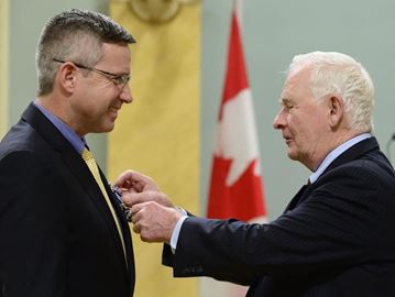 SFDCI history teacher, Blake Seward, receives award from the Governor General of Canada.