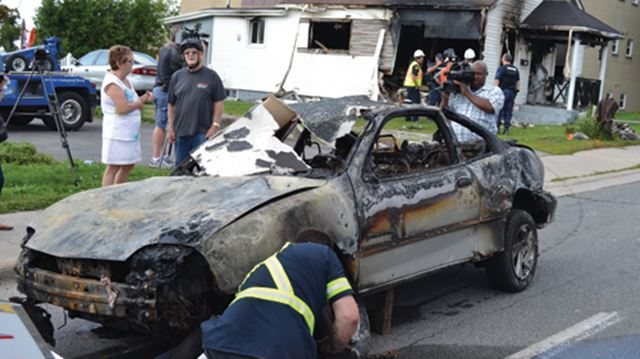 Car extricated from house