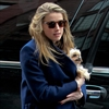Amber Heard's billionaire boyfriend 'very attentive' to her-Image1