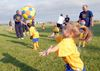 Parents and children learn soccer skills together in Stouffville