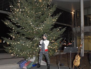 Tori Hathaway, 14, performs at the Bradford Tree Lighting Ceremony Friday evening.
