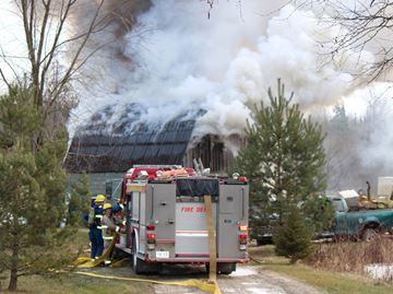 Georgina firefighters contained a fire in a storage workshop on Smith Boulevard just west of Weir's Sideroad in Pefferlaw Sunday. One firefighter was sent to hospital as a precaution. The blaze caused an estimated $30,000 worth of damage.