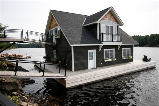 floating boathouse a modern marvel. Black Bedroom Furniture Sets. Home Design Ideas