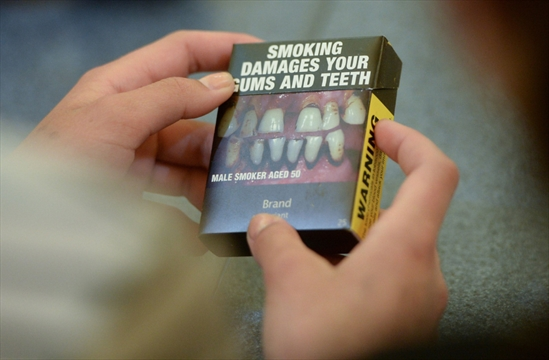 Smoking costs world economy $1 trillion a year