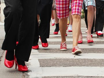 Nearly 70 men donned red heels to help raise $10,000 for the Cambridge YWCA in the 2013 Walk a Mile in Her Shoes.