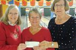 Bowlers' donation will help homeless in Midland