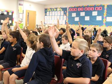 Grade 3 students from Guardian Angels Catholic Elementary School raise their hands to answer questions about concussions during Concussion Awareness Day on Sept. 15. All the schools in the HWCDSB took part in learning about what conncussions are and how to properly treat them.