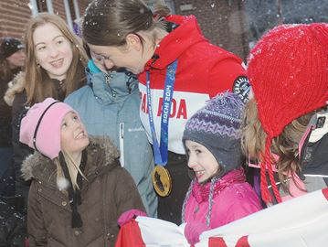 NEWCASTLE -- Tara Watchorn, a member of the Canadian women's hockey team, stopped for fans with her gold medal, as she returned to Newcastle from the Olympic Winter Games in Sochi. February 25, 2014