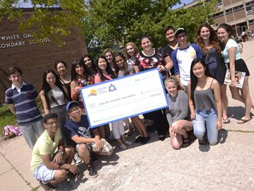 White Oaks Secondary School presents $2,000 cheque to Oakville hospital
