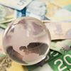 Canadian money and globe