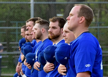 Members of the York Regional Police Blue Sox observe a moment of silence during the Garrett Styles Memorial Baseball Tournament in 2017.