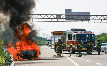Car fire on the QEW