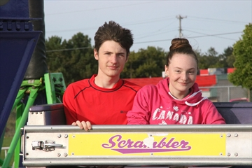 Jared and Briana Szigeti-Jonasson take a spin on the Scrambler in the midway.
