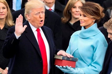 Donald Trump is sworn in as the 45th president of the United States as Melania Trump looks on during the 58th Presidential Inauguration at the U.S. Capitol in Washington on Jan. 20, 2017. In his first 100 days in office, President Donald Trump has produced hundreds of tweets, fired scores of rockets at Syria, signed dozens of executive orders, made one big move on the Supreme Court and signed no major legislation. He's grumbled about the pointlessness of judging presidents by a 100-day standard: