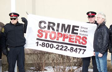 Crime Stoppers flag raising
