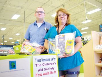 Alliston Staples collecting school supplies for Children's Aid Society program