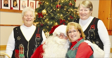 Community - The Smiths Falls Legion hosted Breakfast With Santa Nov. 24, where families were treated to a pancake breakfast and a visit with the Jolly Old Elf. Left, Santa visits with Legion president Carol Levere, left, volunteer Karen MacPherson and ladies auxiliary president Jo Campbell.