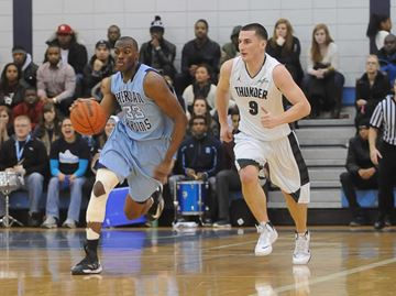 Michael Selkridge of the Sheridan Bruins dribbles  away from Algonquin player Garnet Blais during the Saturday night OCAA men's basketball championship action against the Algonquin Thunder. The Bruins went on to win 76 to 75.
