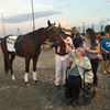 Petting a horse at Kawartha Downs
