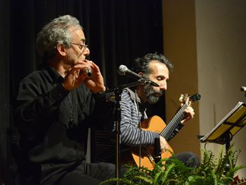 Brian Katz, left, and Jonna Lightstone perform traditional Jewish klezmer music during the Philippine relief concert held Sunday afternoon at the Northview Heights Secondary School auditorium.  (Dec. 8, 2013)