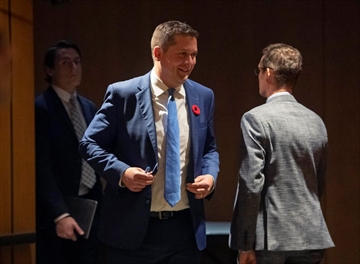 """Conservative Leader Andrew Scheer leaves a room after participating in a vote for caucus chair, during a caucus meeting on Parliament Hill in Ottawa, on Wednesday. He plans to embark on a cross-Canada """"listening tour."""""""